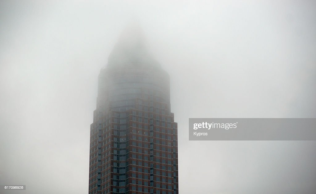 Europe, Germany, Frankfurt, View Of The The Messeturm Or Trade Fair Tower Office Building On Foggy Day. It Is A 257 Meter (843 Ft) Skyscraper With 63-Storeys, The Second Tallest Building In Germany And The Third Tallest Building In The European Union. : Stock Photo