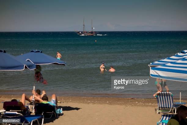 Europe, Greece, Rhodes Island, Faliraki Beach, View Of Beach Chairs And Umbrellas