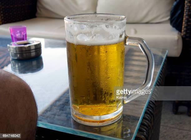 Europe, Greece, Rhodes Island, Faliraki Beach, View Of Cold Beer Mug With Frosty Glass