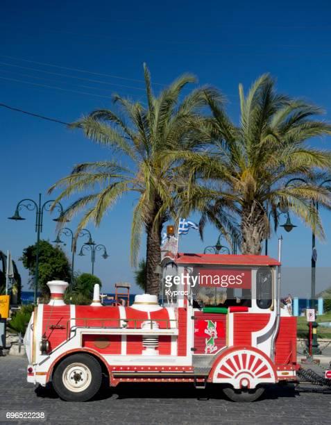Europe, Greece, Rhodes Island, Faliraki Beach, View Of Tourist Train (Tractor) Transport