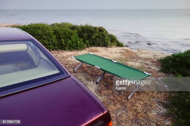 Europe, Greece, Rhodes Island, View Of Camp Bed Combined With Sports Car Equals Hotel Free Travel
