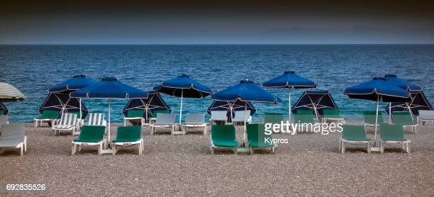 Europe, Greece, Rhodes Island, View Of Chairs On Deserted Greek Beach