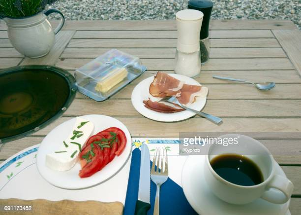 Europe, Greece, Rhodes Island, View Of German Breakfast With Home-Made Goats Cheese And Homegrown Tomato