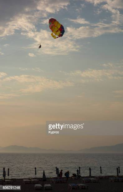 Europe, Greece, Rhodes Island, View Of Paraglider Above Tourists On Beach