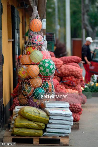 Europe, Hungary, View Of General Store Selling Sacks Of Onions And Plastic Footballs
