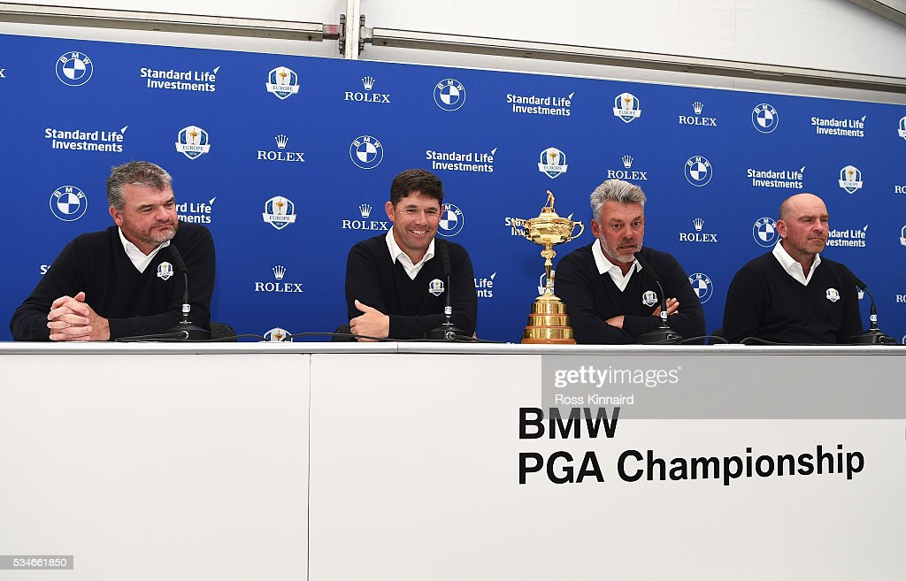 Ryder Cup Captain <a gi-track='captionPersonalityLinkClicked' href=/galleries/search?phrase=Darren+Clarke&family=editorial&specificpeople=171309 ng-click='$event.stopPropagation()'>Darren Clarke</a> (2ndR) of Northern Ireland looks on with his vice-captains <a gi-track='captionPersonalityLinkClicked' href=/galleries/search?phrase=Paul+Lawrie&family=editorial&specificpeople=202995 ng-click='$event.stopPropagation()'>Paul Lawrie</a> (L) of Scotland, <a gi-track='captionPersonalityLinkClicked' href=/galleries/search?phrase=Padraig+Harrington&family=editorial&specificpeople=175865 ng-click='$event.stopPropagation()'>Padraig Harrington</a> of Ireland and <a gi-track='captionPersonalityLinkClicked' href=/galleries/search?phrase=Thomas+Bjorn&family=editorial&specificpeople=202171 ng-click='$event.stopPropagation()'>Thomas Bjorn</a> (R) of Denmark during a press conference on day two of the BMW PGA Championship at Wentworth on May 27, 2016 in Virginia Water, England.