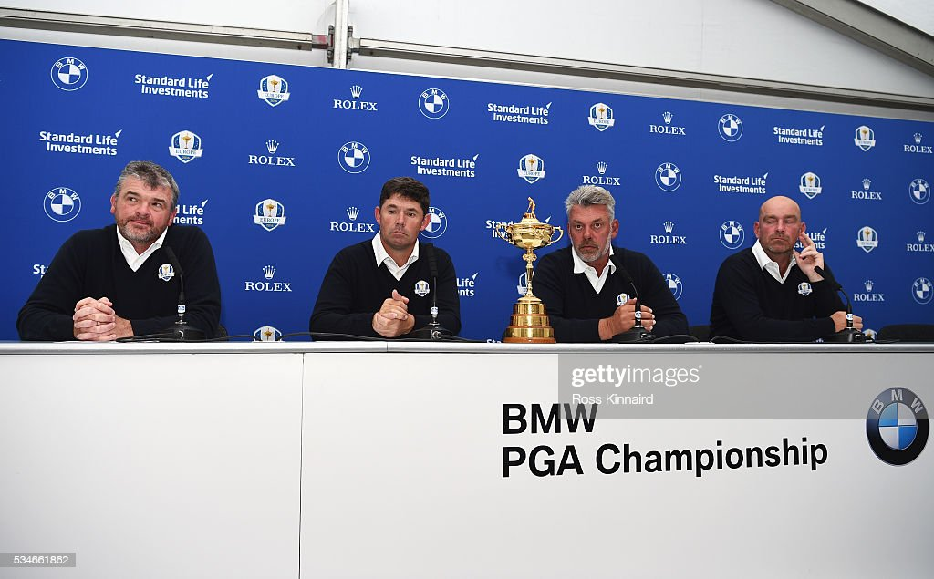 Ryder Cup Captain <a gi-track='captionPersonalityLinkClicked' href=/galleries/search?phrase=Darren+Clarke&family=editorial&specificpeople=171309 ng-click='$event.stopPropagation()'>Darren Clarke</a> (2ndR) of Northern Ireland looks on with his vice-captains <a gi-track='captionPersonalityLinkClicked' href=/galleries/search?phrase=Paul+Lawrie&family=editorial&specificpeople=202995 ng-click='$event.stopPropagation()'>Paul Lawrie</a> (L) of Scotland, <a gi-track='captionPersonalityLinkClicked' href=/galleries/search?phrase=Padraig+Harrington&family=editorial&specificpeople=175865 ng-click='$event.stopPropagation()'>Padraig Harrington</a> of Ireland and Thomas Bjorn (R) of Denmark during a press conference on day two of the BMW PGA Championship at Wentworth on May 27, 2016 in Virginia Water, England.