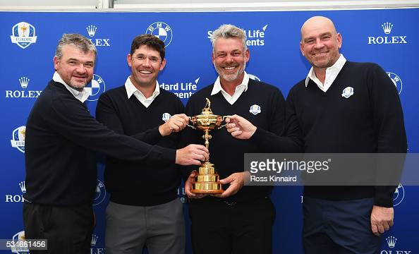 Europe Ryder Cup Captain Darren Clarke of Northern Ireland poses with the Ryder Cup and his vicecaptains Paul Lawrie of Scotland Padraig Harrington...