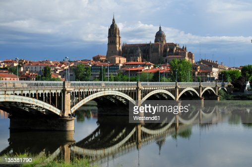 Europe, Spain, Castile and Leon, Salamanca, View of cathedral in city and bridge across Rio Tormes