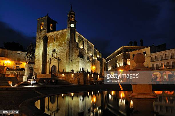 Europe, Spain, Extremadura, Trujillo, Night view of Plaza Mayor city square and San Martin church with fountain in foreground