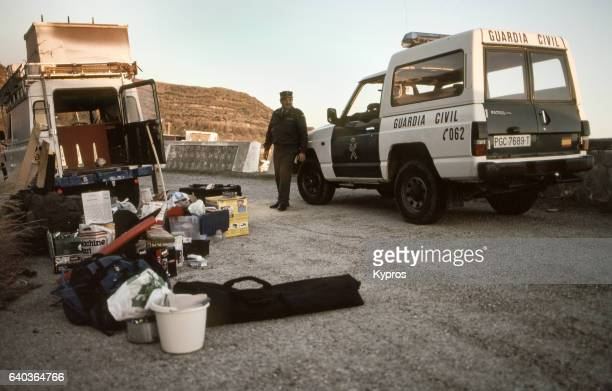 Europe, Spain, View Of Camping Equipment Roadside Sort And Police Warning About Possibility Of Bandit Attack Before Crossing From Europe To Africa (Year 2000)