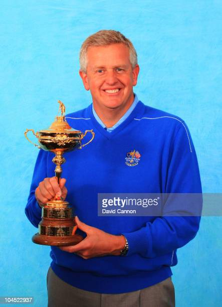 Europe Team Captain Colin Montgomerie poses with the trophy during the European Team Photocall prior to the 2010 Ryder Cup at the Celtic Manor Resort...