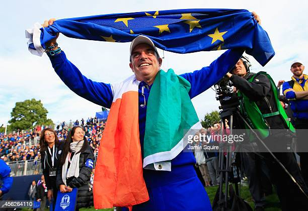 Europe team captain Paul McGinley celebrates winning the Ryder Cup during the Singles Matches of the 2014 Ryder Cup on the PGA Centenary course at...