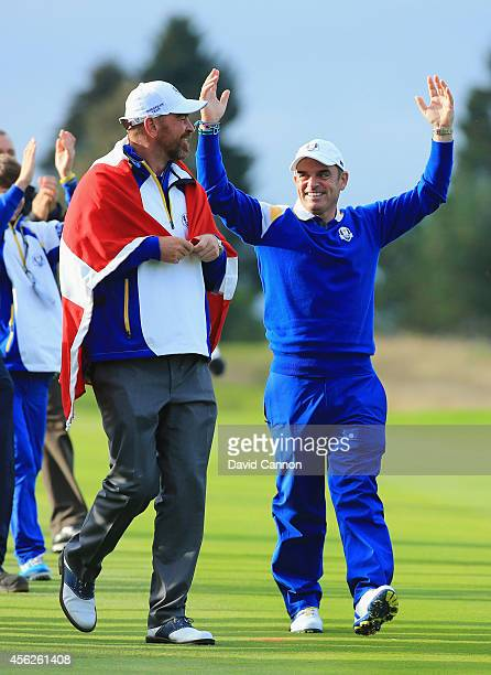 Europe team captain Paul McGinley celebrates with Thomas Bjorn as Europe won the Ryder Cup on the 15th hole with victory by Jamie Donaldson of Europe...