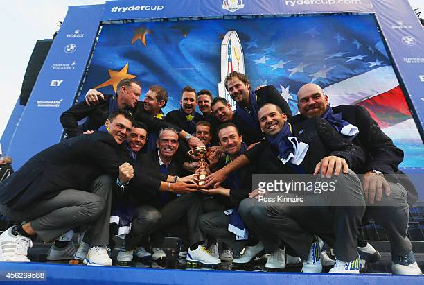 Europe team captain Paul McGinley poses with the Ryder Cup trophy and his team after the Singles Matches of the 2014 Ryder Cup on the PGA Centenary...