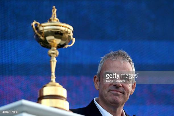 Europe team captain Paul McGinley poses with the Ryder Cup trophy after the Singles Matches of the 2014 Ryder Cup on the PGA Centenary course at the...