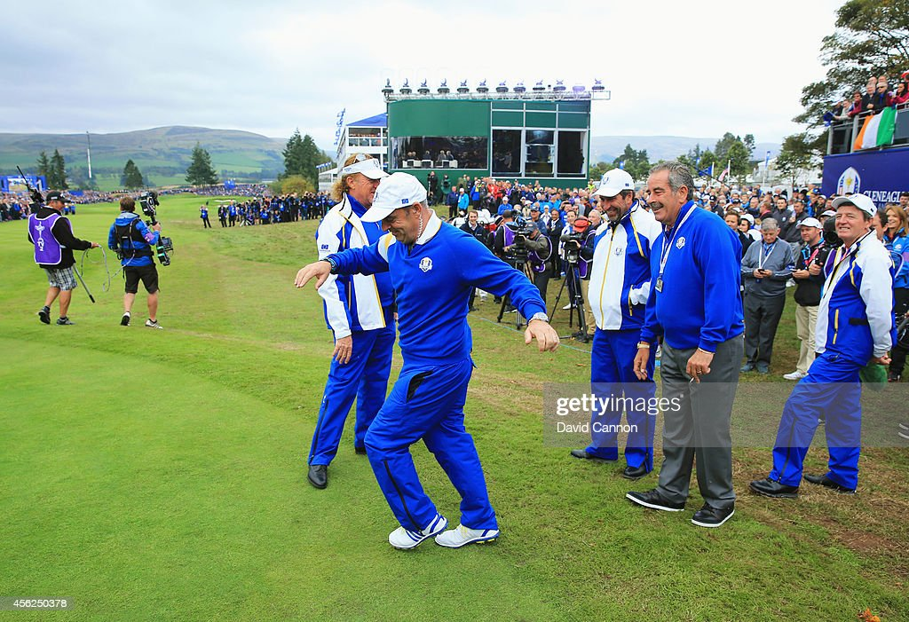 Europe team captain <a gi-track='captionPersonalityLinkClicked' href=/galleries/search?phrase=Paul+McGinley&family=editorial&specificpeople=178983 ng-click='$event.stopPropagation()'>Paul McGinley</a> shares a joke with Europe team vice captains <a gi-track='captionPersonalityLinkClicked' href=/galleries/search?phrase=Jose+Maria+Olazabal&family=editorial&specificpeople=176521 ng-click='$event.stopPropagation()'>Jose Maria Olazabal</a>, <a gi-track='captionPersonalityLinkClicked' href=/galleries/search?phrase=Sam+Torrance&family=editorial&specificpeople=204630 ng-click='$event.stopPropagation()'>Sam Torrance</a>, <a gi-track='captionPersonalityLinkClicked' href=/galleries/search?phrase=Miguel+Angel+Jimenez&family=editorial&specificpeople=171700 ng-click='$event.stopPropagation()'>Miguel Angel Jimenez</a> and <a gi-track='captionPersonalityLinkClicked' href=/galleries/search?phrase=Des+Smyth&family=editorial&specificpeople=214232 ng-click='$event.stopPropagation()'>Des Smyth</a> during the Singles Matches of the 2014 Ryder Cup on the PGA Centenary course at the Gleneagles Hotel on September 28, 2014 in Auchterarder, Scotland.