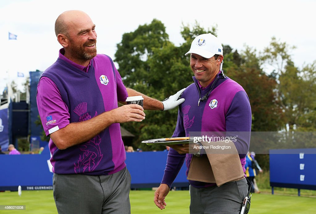 Europe team vice captain <a gi-track='captionPersonalityLinkClicked' href=/galleries/search?phrase=Padraig+Harrington&family=editorial&specificpeople=175865 ng-click='$event.stopPropagation()'>Padraig Harrington</a> acts as a waiter for <a gi-track='captionPersonalityLinkClicked' href=/galleries/search?phrase=Thomas+Bjorn&family=editorial&specificpeople=202171 ng-click='$event.stopPropagation()'>Thomas Bjorn</a> of Europe during practice ahead of the 2014 Ryder Cup on the PGA Centenary course at the Gleneagles Hotel on September 24, 2014 in Auchterarder, Scotland.