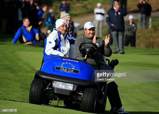 Europe team vice captain Sam Torrance and son Daniel Torrance look on during the Morning Fourballs of the 2014 Ryder Cup on the PGA Centenary course...