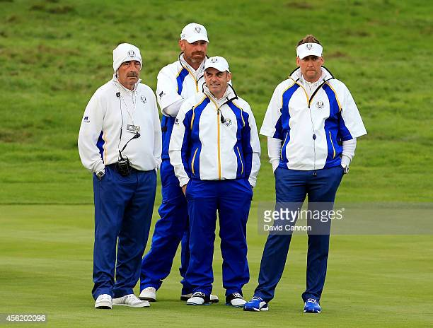 Europe team vice captain Sam Torrance Thomas Bjorn of Europe Europe team captain Paul McGinley and Ian Poulter of Europe look on from the fairway...