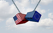Europe USA trade war and American tariffs as two opposing cargo freight containers in European Union economic conflict as a dispute over import and exports as a 3D illustration.