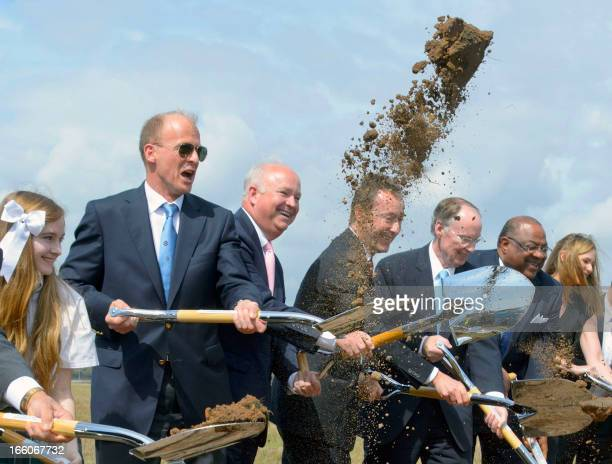 European Aeronautic Defence and Space Company CEO Tom Enders gets into the spirt of a ground breaking ceremony by tossing dirt in the air for an...