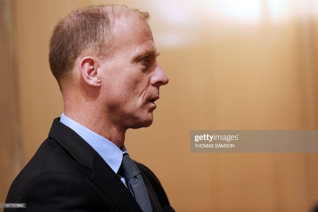 European Aeronautic Defence and Space company (EADS) German CEO Tom Enders looks on December 6, 2012 in Paris, where he is to meet with French Minister of Economy, Finance and Foreign Trade Pierre Moscovici. The French director for strategy at EADS, Marwan Lahoud, described the company's share restructuring announced late on December 5, which ends the ability of the French and German governments effectively to control the group, as a 'new birth.'