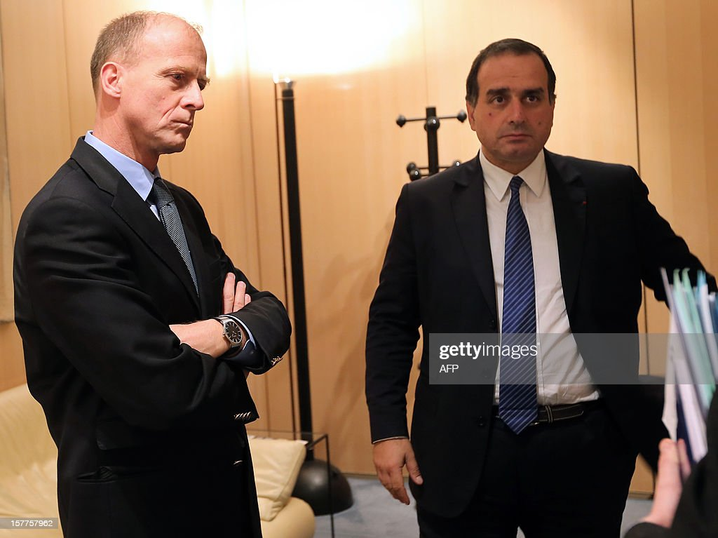 European Aeronautic Defence and Space company (EADS) German CEO Tom Enders (L) and French director for strategy at EADS Marwan Lahoud (R) attend a meeting with French Minister of Economy, Finance and Foreign Trade Pierre Moscovici (not pictured) on December 6, 2012 in Paris. Lahoud, described the company's share restructuring announced late on December 5, which ends the ability of the French and German governments effectively to control the group, as a 'new birth.'