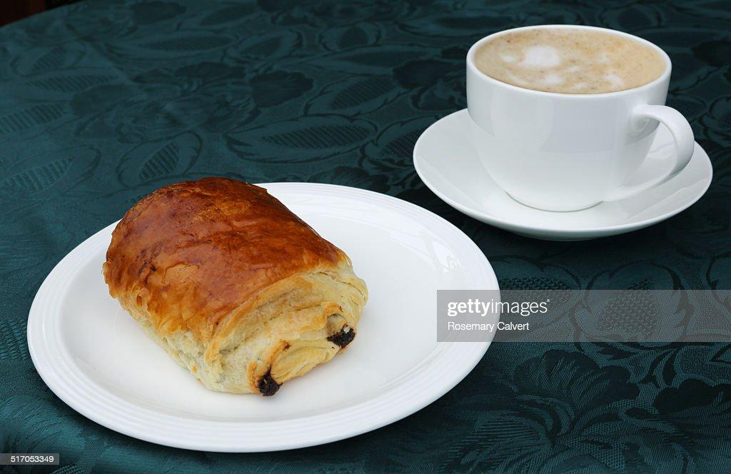European breakfast of pain au chocolat and coffee.
