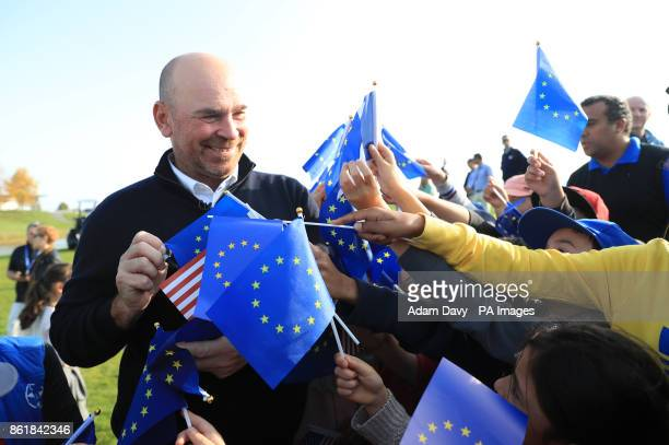European captain Thomas Bjorn is swamped by young fans with flags during a media event ahead of the 2018 Ryder Cup at Le Golf National Paris