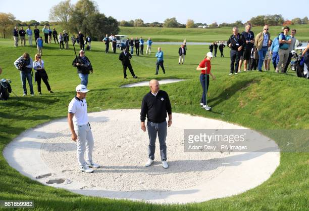 European captain Thomas Bjorn with a member of the Euorpe Junior Ryder Cup team during a media event ahead of the 2018 Ryder Cup at Le Golf National...