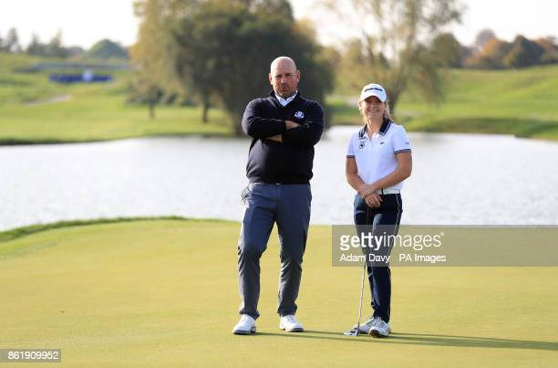 European captain Thomas Bjorn with a member of the Europe Junior Ryder Cup team hits a few practice balls during a media event ahead of the 2018...