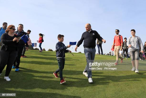 European captain Thomas Bjorn with a young fan during a media event ahead of the 2018 Ryder Cup at Le Golf National Paris