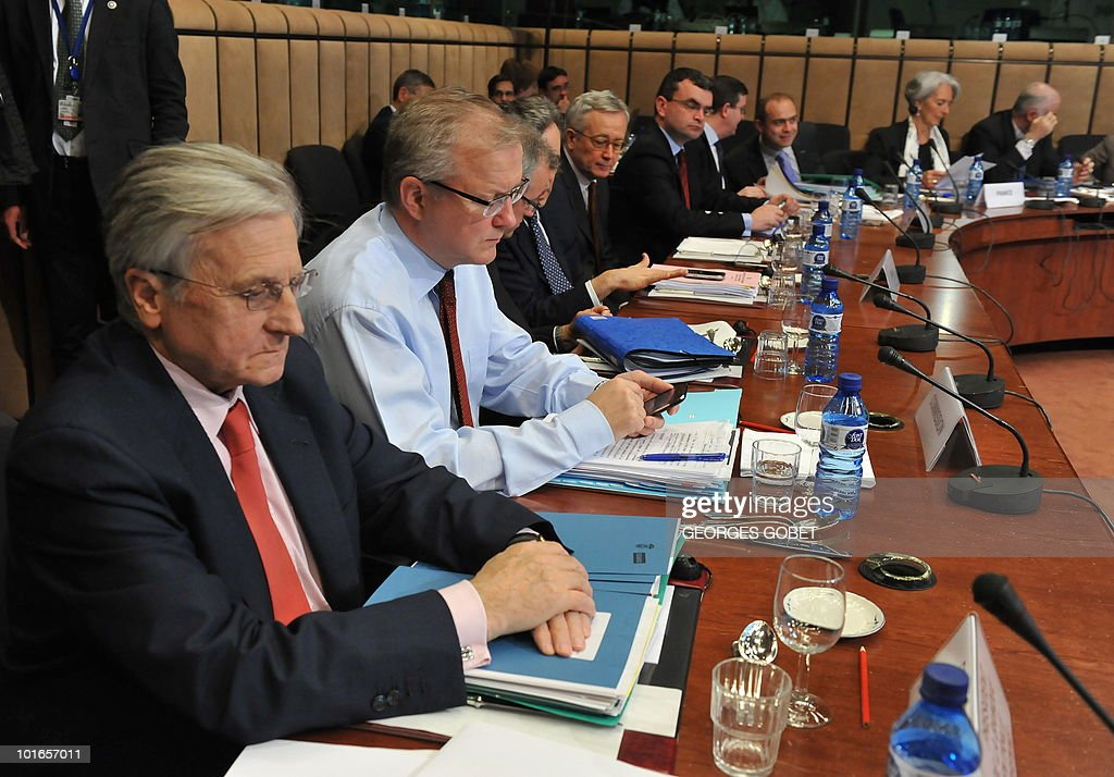European Central Bank president Jean Claude Trichet and EU commissioner for Economic and Monetary Affairs Olli Rehn (LtR) set up on May 17,2010 prior to an Eurogroup meeting at the EU headquarters in Brussels.