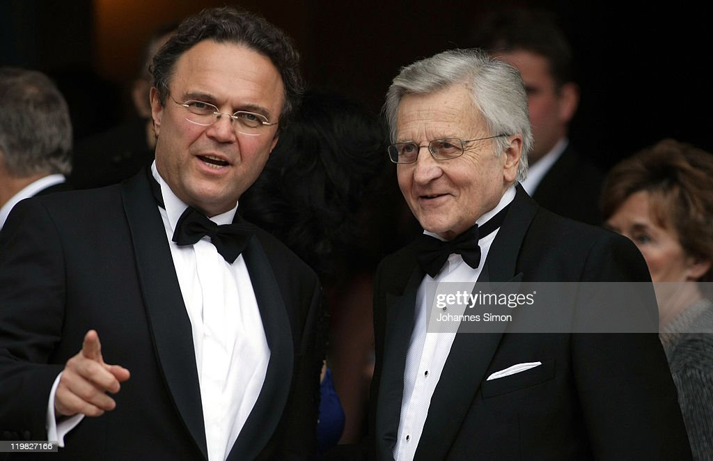 European Central Bank President JeanClaude Trichet and German Interior Minister HansPeter Friedrich arrive for the Bayreuth festival 2011 premiere on...