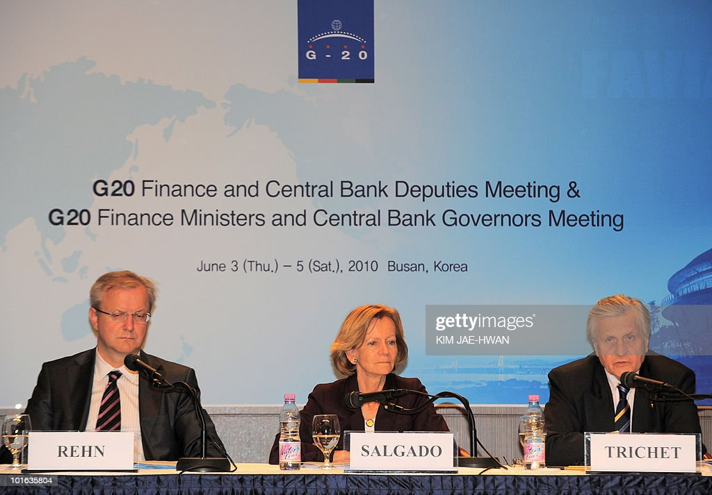 European Central Bank President Jean-Clauede Trichet (R) speaks to the media with Elena Salgado (C) and Spanish presidency of EU and Olli Rehan (L), European Commissioner for Economic and Monetary Affairs during the EU press conference of the G20 Finance Ministers and Central Bank Governors meeting in Busan June 5, 2010. Market convulsions sparked by Europe's debt crisis show that major challenges remain to global economic recovery, G20 nations said as they vowed to fix their fiscal houses.