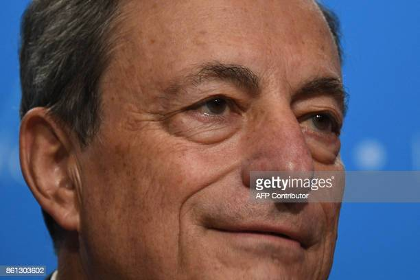 European Central Bank president Mario Draghi speaks during a press conference at the World Bank and International Monetary Fund annual meeting in...