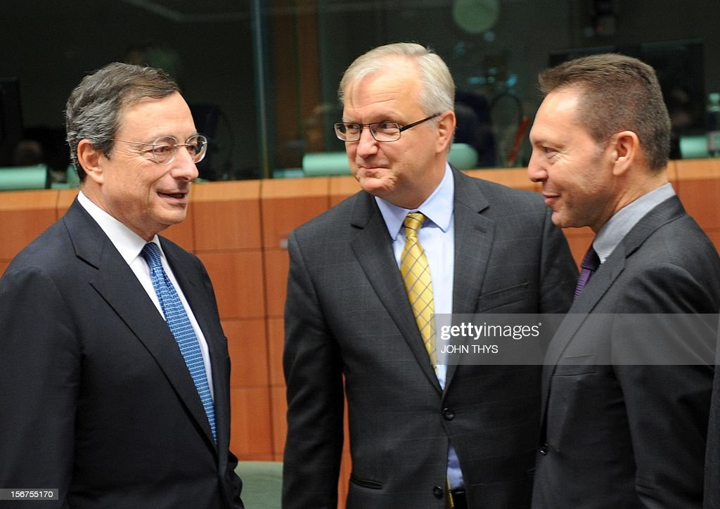 European Central Bank president Mario Draghi (L) speaks with EU commissioner for Economic and Monetary Affairs Olli Rehn (C), and Greek Finance Minister Ioannis Stournaras (R), before an Eurozone finance ministers meeting to decide on a fresh rescue loan for debt-stricken Greece, on November 20, 2012 at EU headquarters in Brussels. Greece has 'delivered' on reform and a deal will likely be clinched to unblock funds to keep it from bankruptcy, the head of the Eurogroup insisted despite a split with the IMF over how to get the stricken country's economic recovery on track.