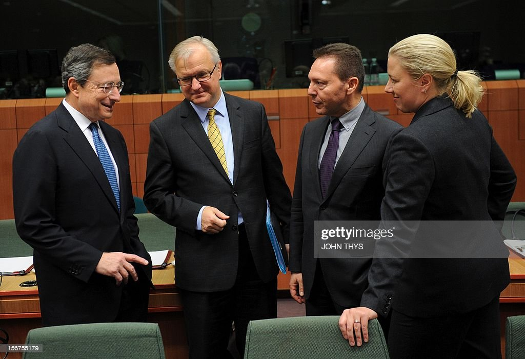 European Central Bank president Mario Draghi (L) speaks with EU commissioner for Economic and Monetary Affairs Olli Rehn (2nd L), Greek Finance Minister Ioannis Stournaras (2nd R) and Finnish Finance Minister Jutta Urpilainen (R) before an Eurozone finance ministers meeting to decide on a fresh rescue loan for debt-stricken Greece, on November 20, 2012 at EU headquarters in Brussels. Greece has 'delivered' on reform and a deal will likely be clinched to unblock funds to keep it from bankruptcy, the head of the Eurogroup insisted despite a split with the IMF over how to get the stricken country's economic recovery on track.