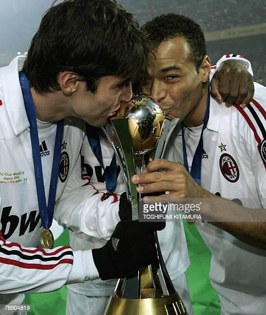 European champion AC Milan forward Kaka and defender Cafu kiss the Club World Cup trophy in Yokohama 16 December 2007 AC Milan beat South American...