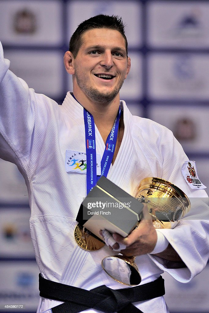 European champion and under 100kg gold medallist, <a gi-track='captionPersonalityLinkClicked' href=/galleries/search?phrase=Lukas+Krpalek&family=editorial&specificpeople=6589582 ng-click='$event.stopPropagation()'>Lukas Krpalek</a> of the Czech Republic waves to his fans during the Chelyabinsk Judo World Championships at the Sport Arena 'Traktor' on August 30, 2014 in Chelyabinsk, Russia.