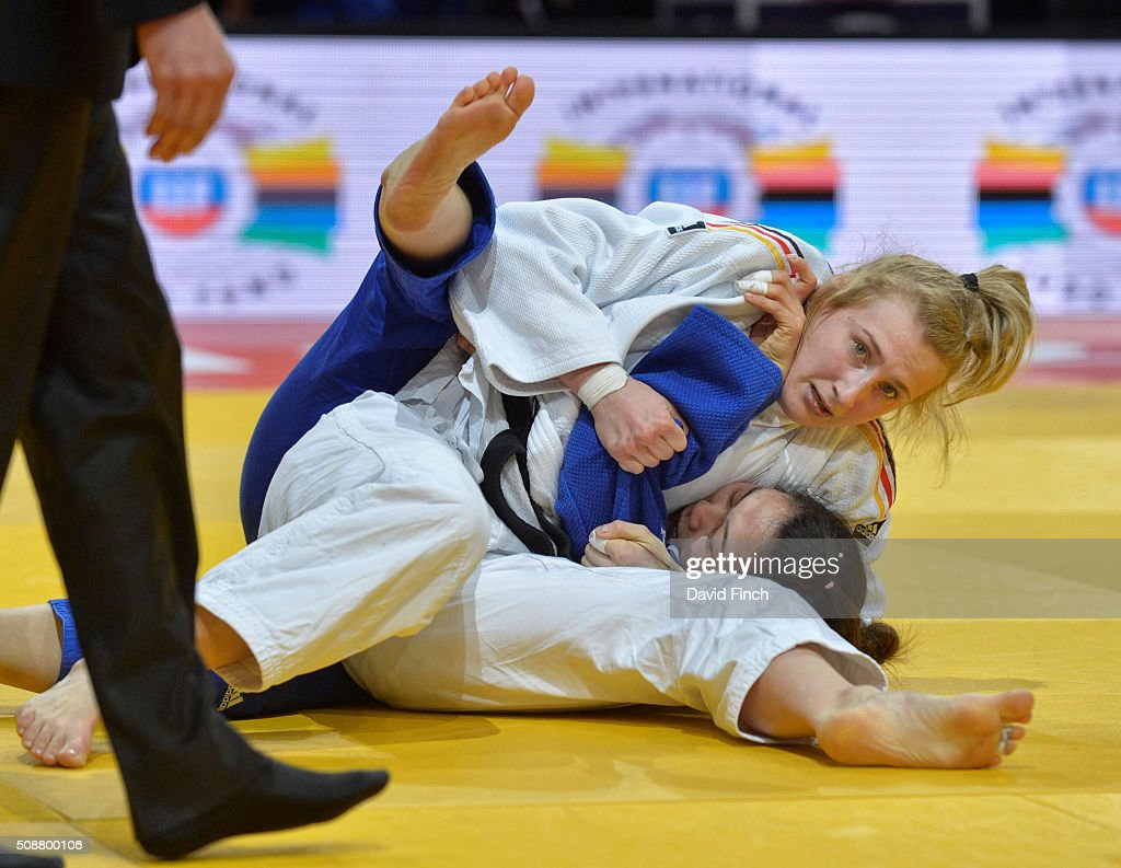 European champion Martyna Trajdos of Germany holds Seulgi Kim of South Korea for an ippon on her way to the u63kg bronze medal during the 2016 Paris...