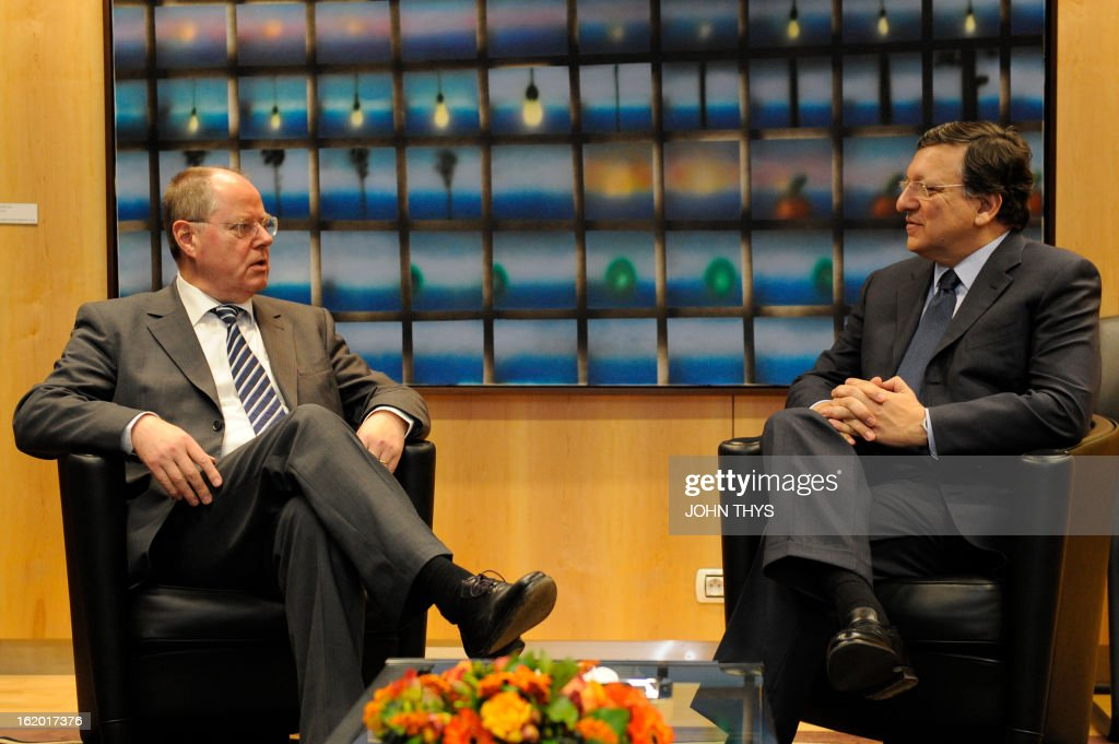 European Commission Chiarman Jose Manuel Barroso (R) welcomes German Social Democrat (SPD) leader Peer Steinbruck on February 18, 2013 before a meeting at EU headquarters in Brussels .