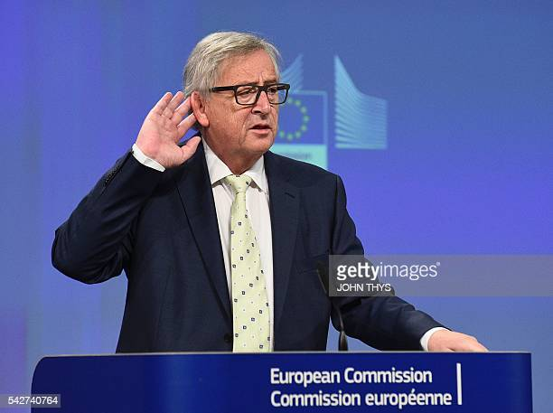 European Commission chief JeanClaude Juncker gestures during a joint press conference following his meeting with the President of the European...