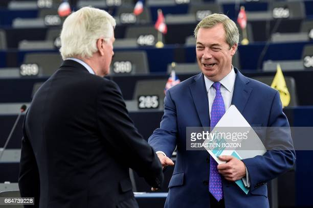 European commission member in charge of Brexit negotiations with Britain French Michel Barnier shakes hands with Member of the European Parliament...
