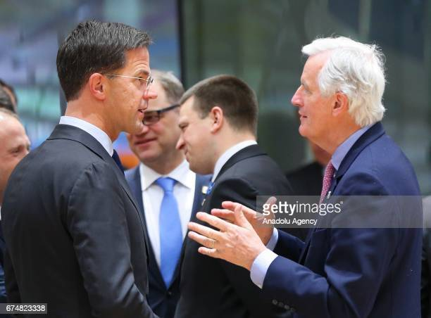 European commission member in charge of Brexit negotiations with Britain French Michel Barnier speaks with Dutch Prime Minister Mark Rutte during a...