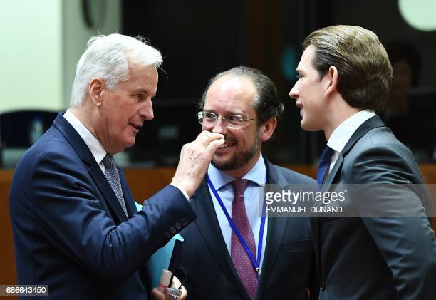 European Commission member in charge of Brexit negotiations with Britain Michel Barnier talks with Austria's Foreign Minister Sebastian Kurz during a...