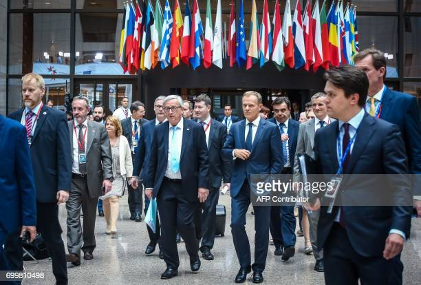 European Commission President Jean Claude Juncker and European Council President Donald Tusk arrive to address a joint press conference on the...