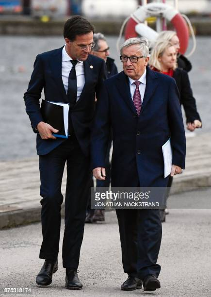 European Commission President Jean Claude Juncker and The Netherlands Prime Minister Mark Rutte talk after leaving the luncheon during the European...