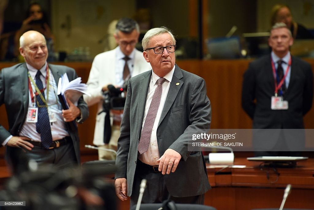 European Commission President Jean Claude Juncker (R) looks on as he walks during EU - Summit at the EU headquarters in Brussels on June 28, 2016. Prime Minister David Cameron said today he wants the 'closest possible' relations with the EU after Britain voted to leave the bloc, adding the split should be 'as constructive as possible'. As he arrived at a Brussels summit, Cameron, who is to step down within weeks, told reporters that, while Britain was leaving the EU, 'we mustn't be turning our backs on Europe.' SAKUTIN